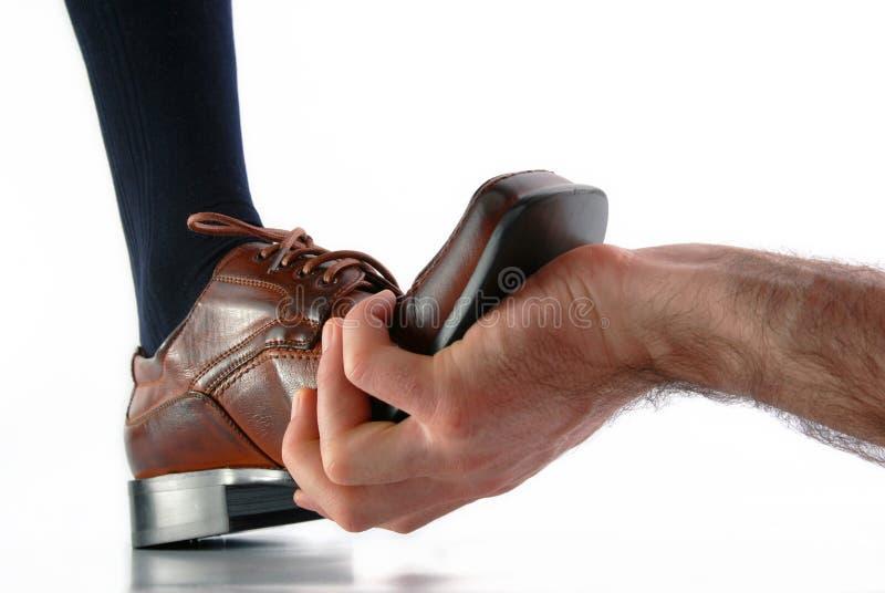 Mão e pé na tensão imagem de stock
