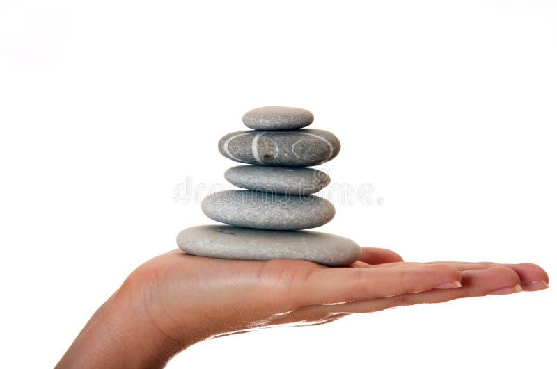 Mão e pedras fotos de stock