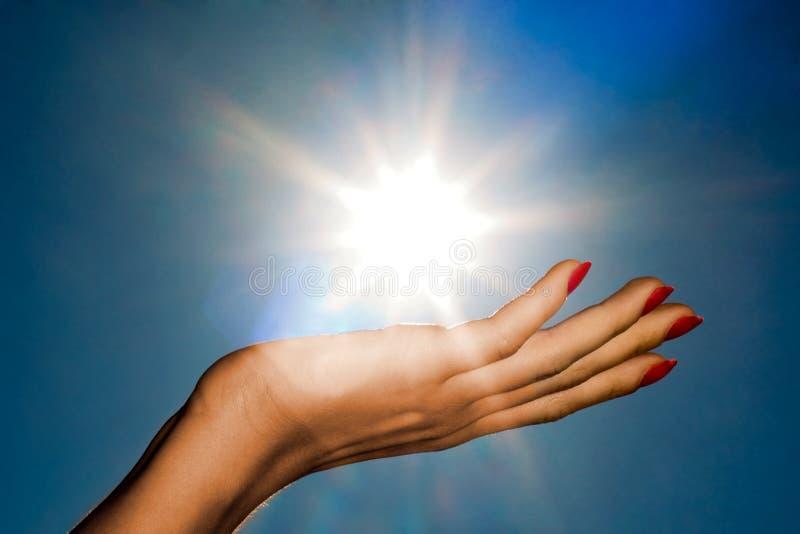 Mão e sol imagens de stock royalty free
