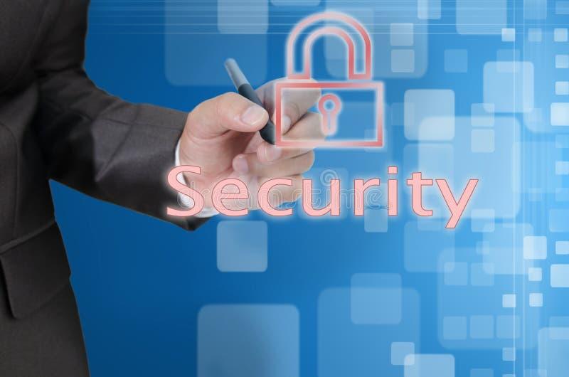 A mão escreve o conceito da segurança no fundo abstrato fotografia de stock royalty free