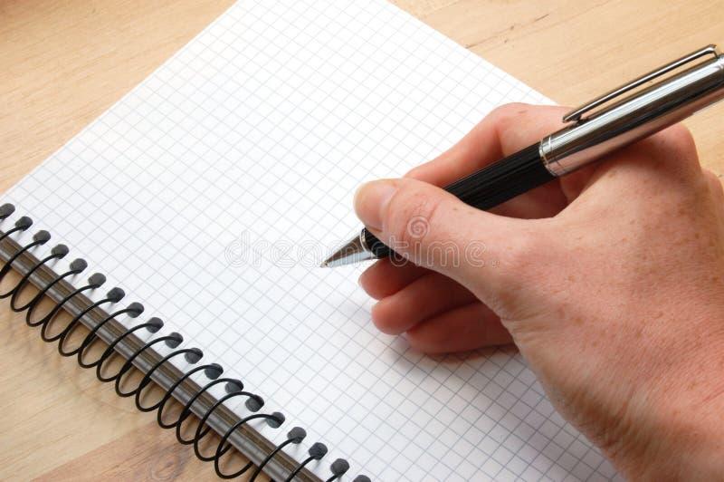 A mão escreve uma mensagem fotografia de stock royalty free