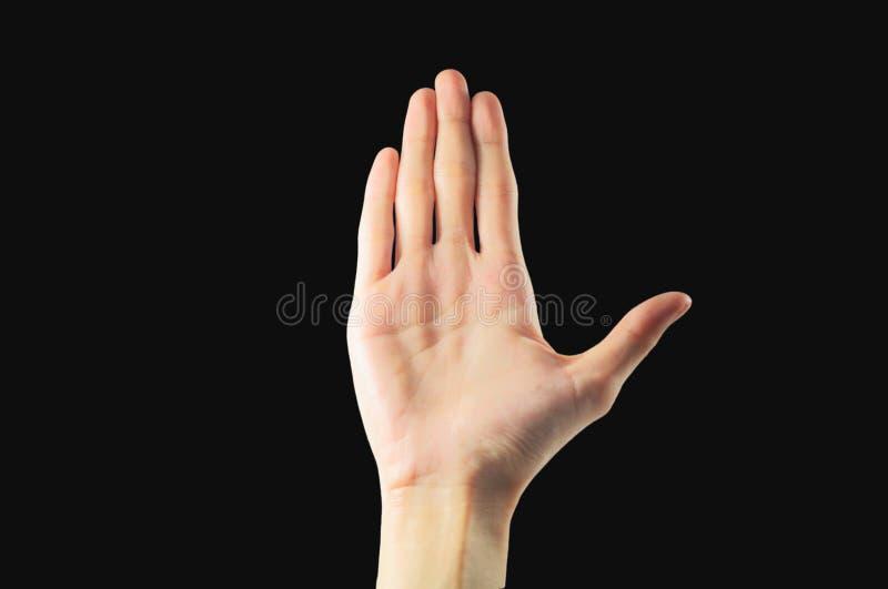 Mão fêmea bonita isolada no fundo preto, asiático, yello imagem de stock