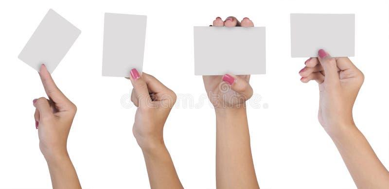 Mão fêmea com cartão em branco fotos de stock