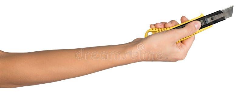 Mão fêmea que guarda a faca do cortador imagens de stock