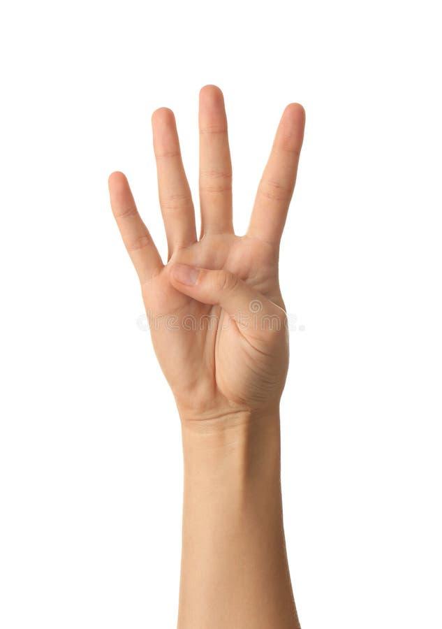 Mão fêmea que mostra quatro dedos no fundo branco imagem de stock