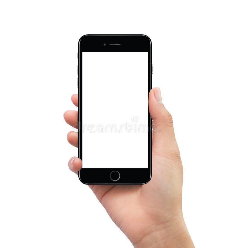 Mão humana isolada que guarda o modelo esperto móvel preto do telefone fotografia de stock