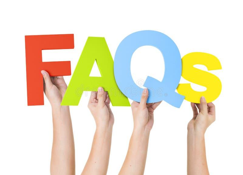 Mão humana que guarda os FAQ da palavra fotografia de stock royalty free