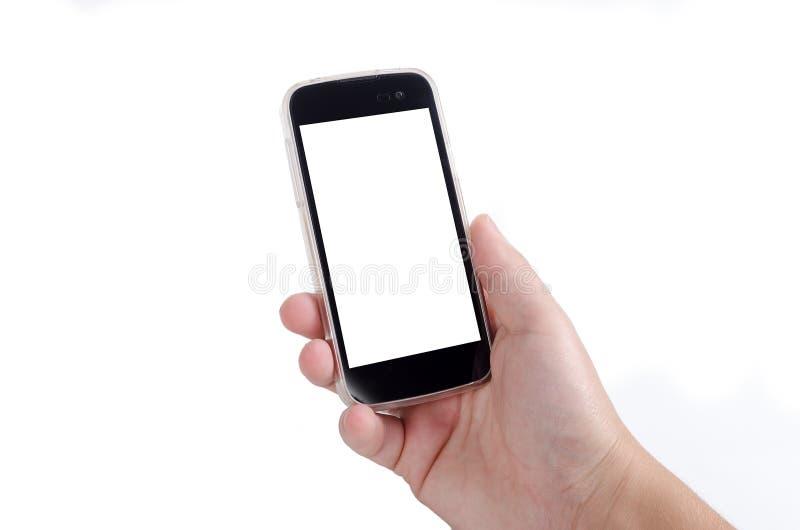 Mão humana que mantém o telefone esperto isolado no fundo branco foto de stock