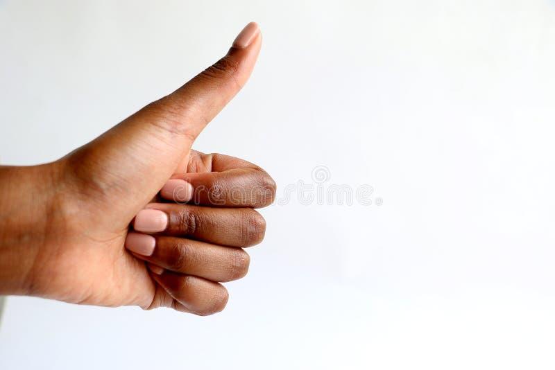 Mão indiana do africano negro que dá os polegares acima foto de stock royalty free