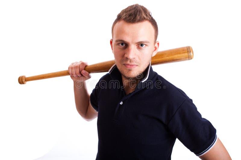 Mão irritada do homem que mantém o bastão de beisebol isolado no branco fotos de stock royalty free