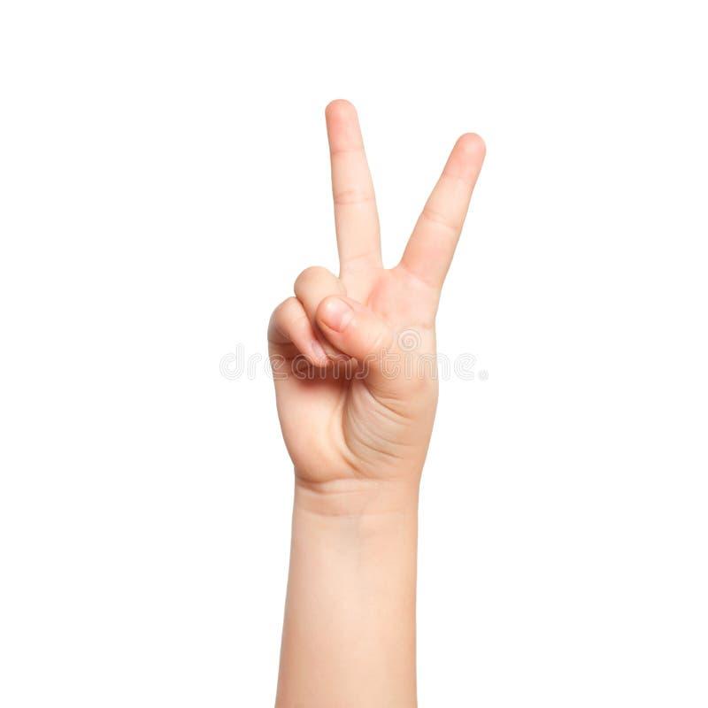 A mão isolada da criança mostra o número dois imagens de stock