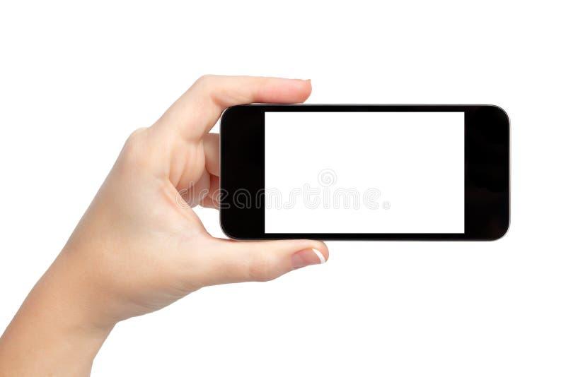 Mão isolada da mulher que prende o telefone fotos de stock royalty free