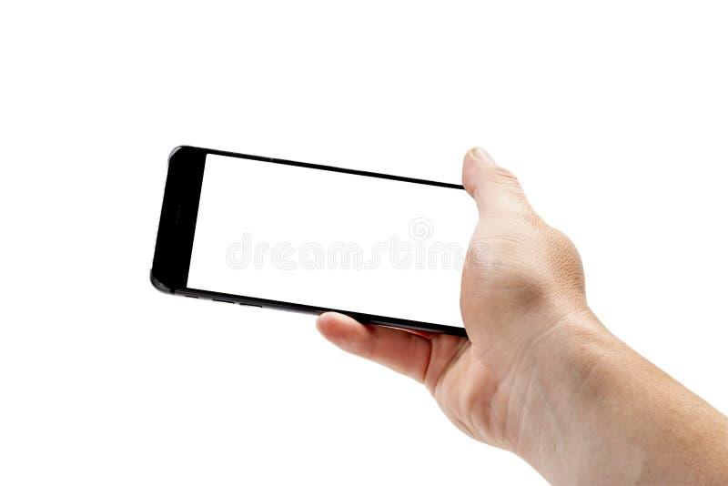 Mão isolada que guarda o smartphone moderno com tela vazia Modelo para o projeto foto de stock