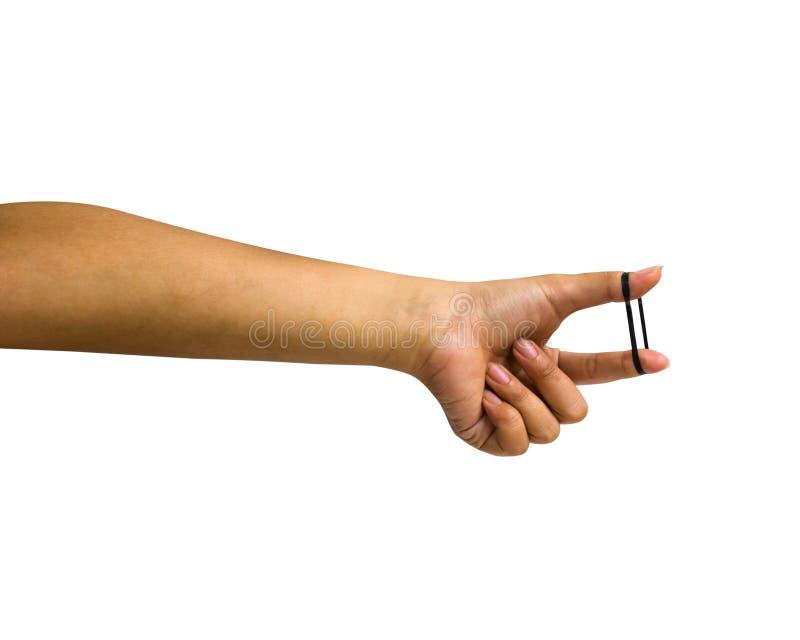 Mão isolada: Uma mão fêmea colhida que guarda o elástico preto fotos de stock