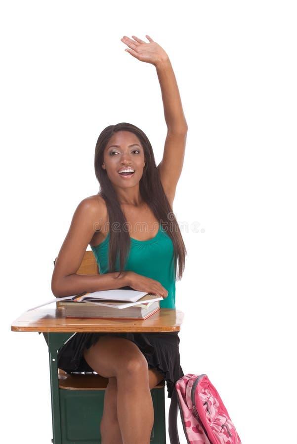 Mão levantada estudante do americano africano na classe fotografia de stock
