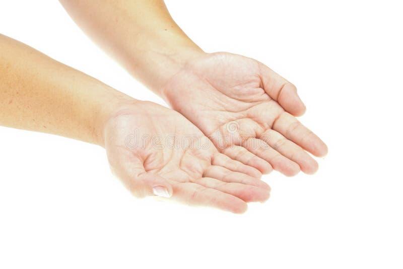 Mão, mãos abertas que prendem um objeto imagens de stock royalty free