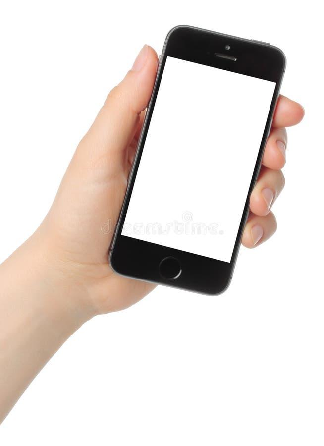 A mão mantém o espaço do iPhone 5s cinzento no fundo branco foto de stock