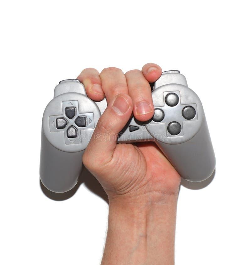 A mão masculina espreme o gamepad imagens de stock