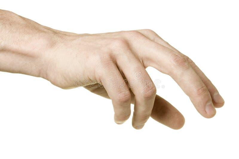 Mão masculina que alcanga para pegarar algo, isolado fotografia de stock