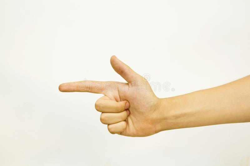 Mão masculina que faz um sinal da arma, isolado no fundo branco imagem de stock royalty free