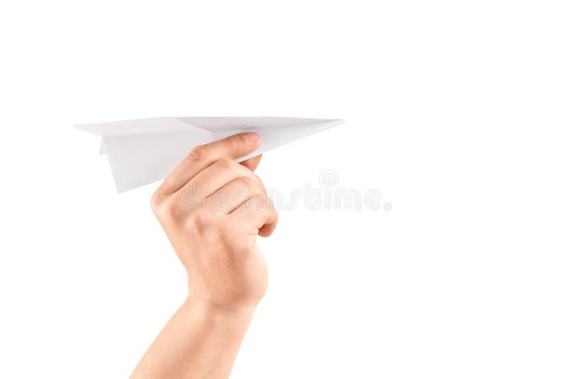 Mão masculina que guarda um avião de papel foto de stock royalty free