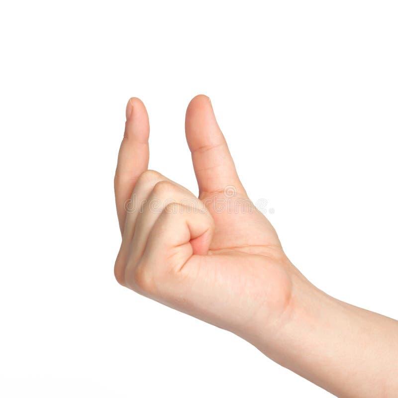 mão masculina que guarda um objeto fotografia de stock