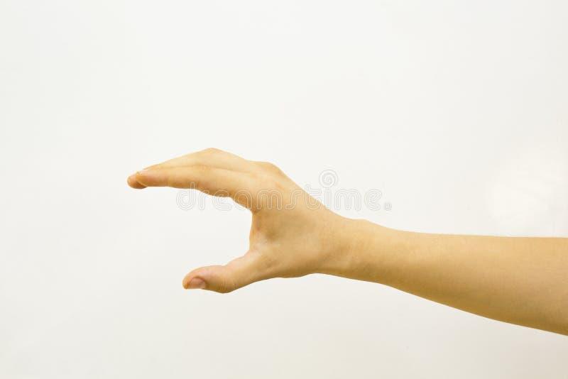 Mão masculina que mantém algo isolado no fundo branco imagens de stock royalty free
