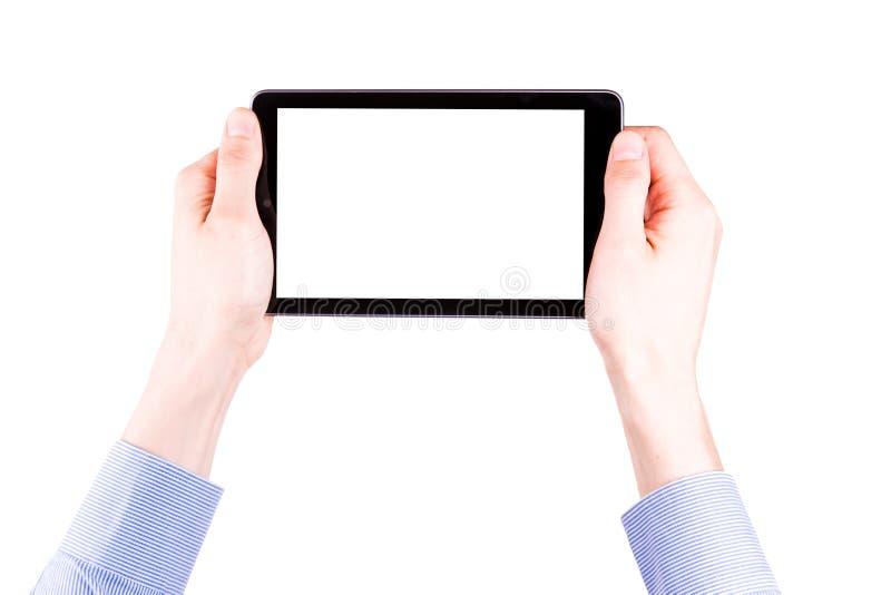 Mão masculina que guardara um PC da tabuleta com espaço para você texto foto de stock royalty free