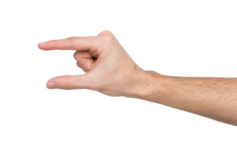 Mão masculina que mede algo, entalhe, gesto imagens de stock