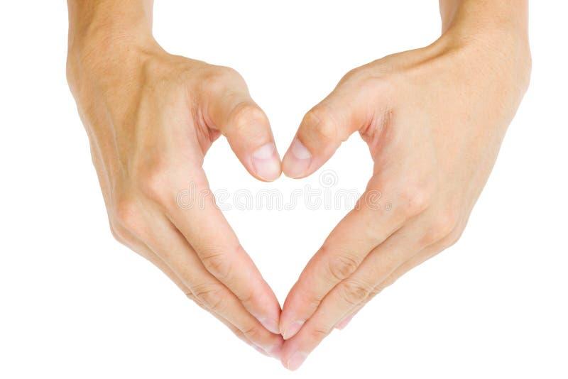 Mão masculina que mostra a forma do coração imagem de stock royalty free