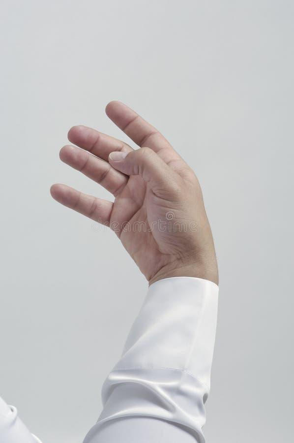 Mão masculina vazia para colocar o telefone celular ou o outro isolado do objeto fotos de stock