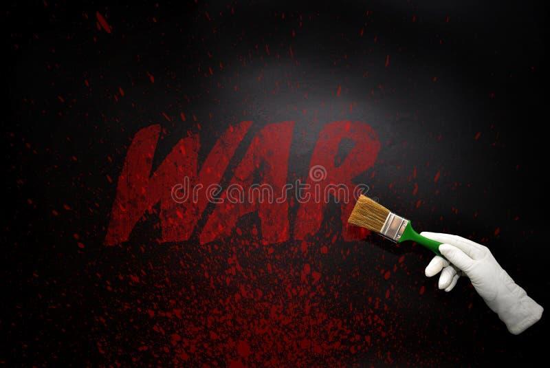 Mão na luva com a escova que pinta a guerra do texto em uma SU preta foto de stock