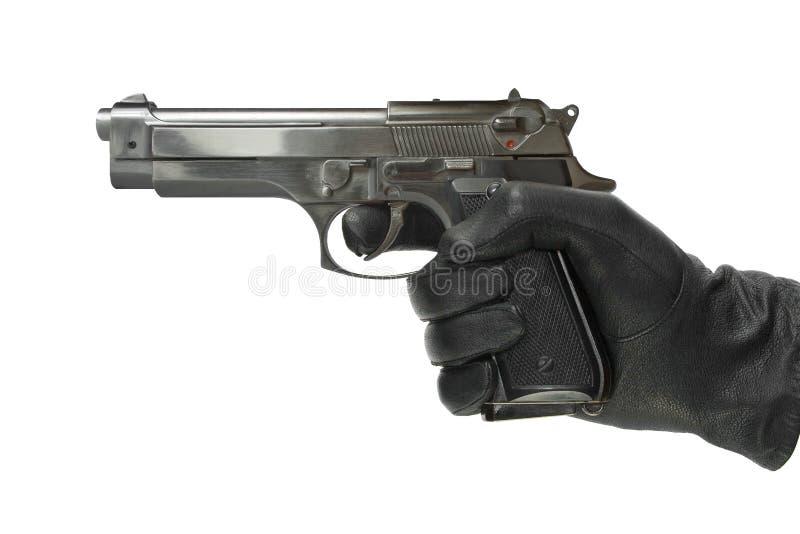 Mão na luva com pistola imagens de stock royalty free