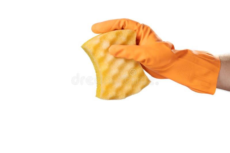 A mão na luva de borracha alaranjada mostra uma lavagem da esponja do sinal ou do símbolo imagem de stock