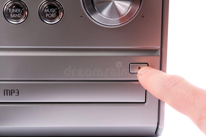 Mão no botão de controle do volume sadio fotografia de stock