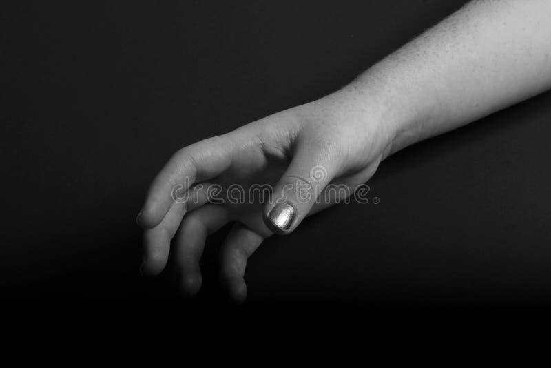 Mão no fundo preto foto de stock royalty free