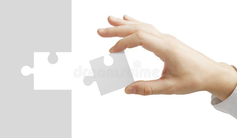 A mão pôr o enigma foto de stock royalty free