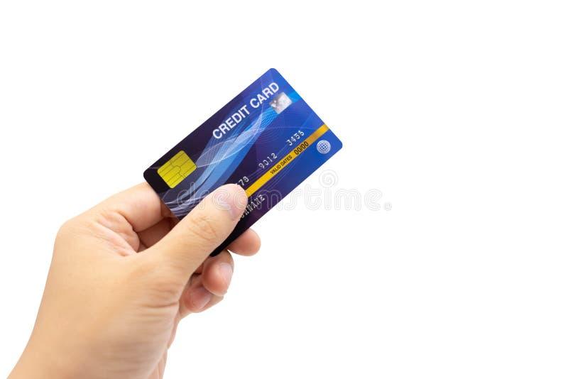 Mão pessoal que guarda o cartão de crédito, fundo branco, dinheiro eletrônico do conceito cashless que cria responsabilidades fotos de stock