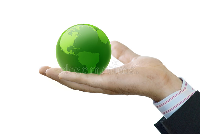 A mão prende o globo fotografia de stock royalty free