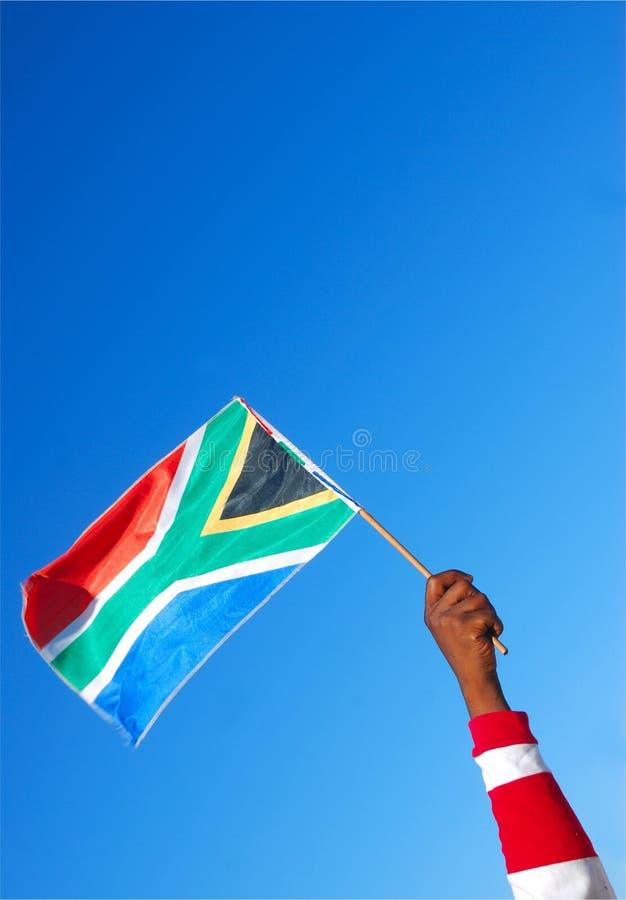 Mão preta com sul - bandeira africana fotografia de stock