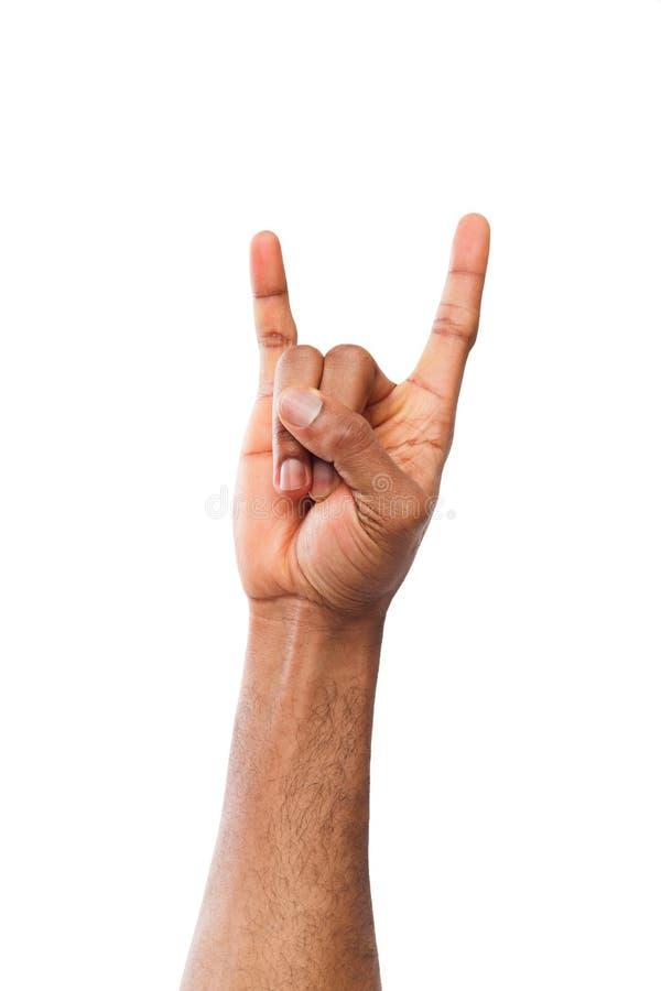 Mão preta masculina que faz o gesto do rolo do ` do ` n da rocha isolado no branco imagem de stock