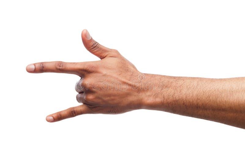 Mão preta masculina que faz o gesto do rolo do ` do ` n da rocha isolado no branco fotos de stock royalty free