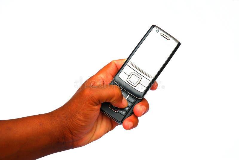 Mão preta usando o telefone móvel fotografia de stock