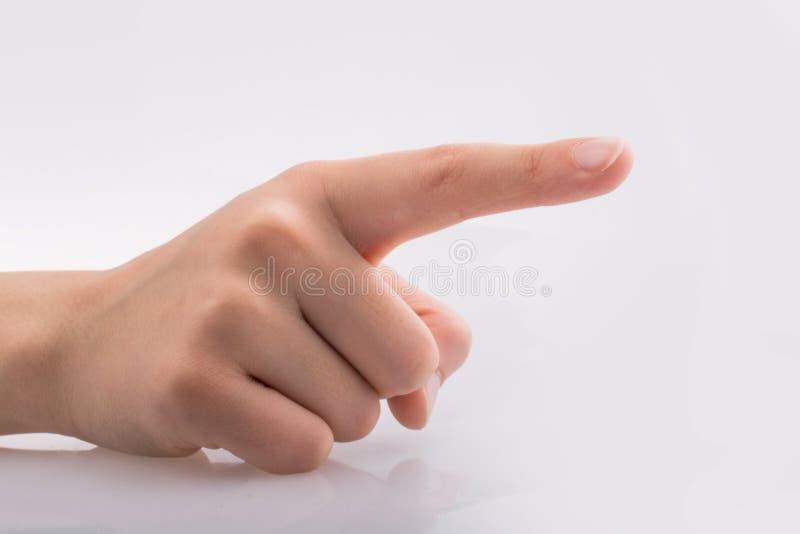 Mão que aponta no fundo branco foto de stock