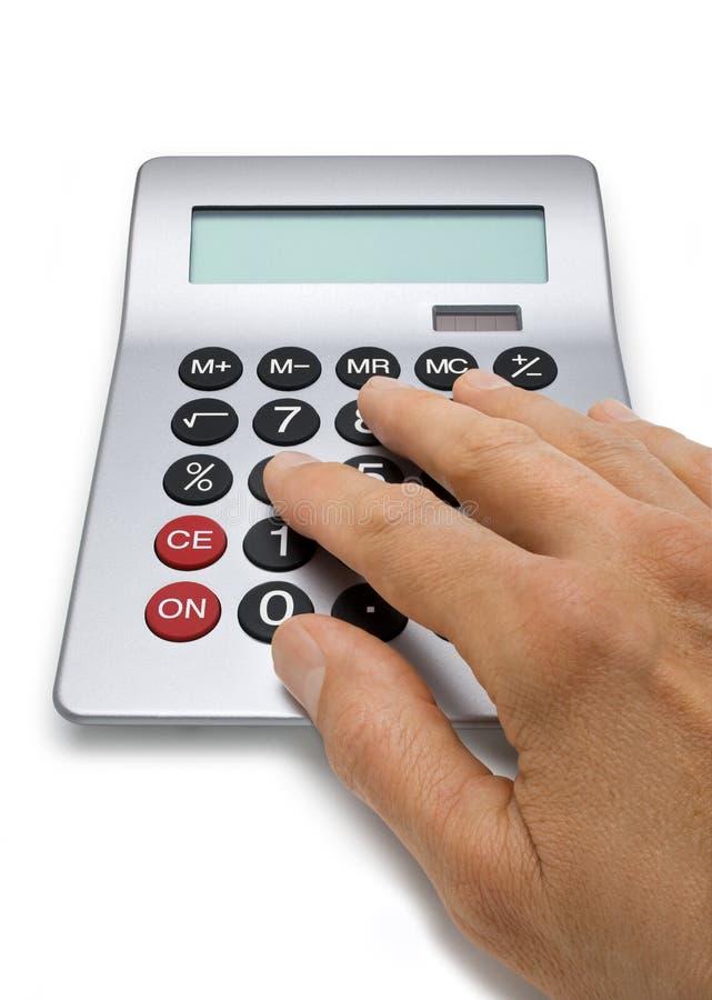 Mão que calcula na calculadora fotografia de stock