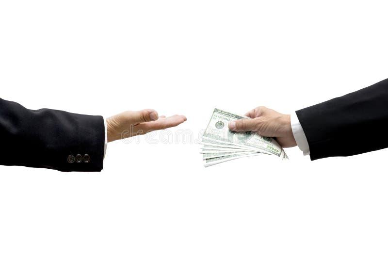 Mão que dá o dinheiro à outra fotografia de stock