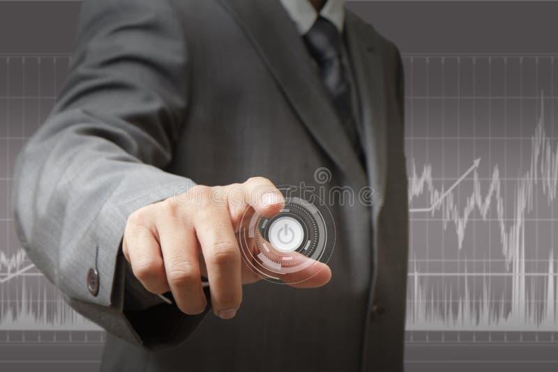 Mão que empurra em um ecrã táctil fotografia de stock