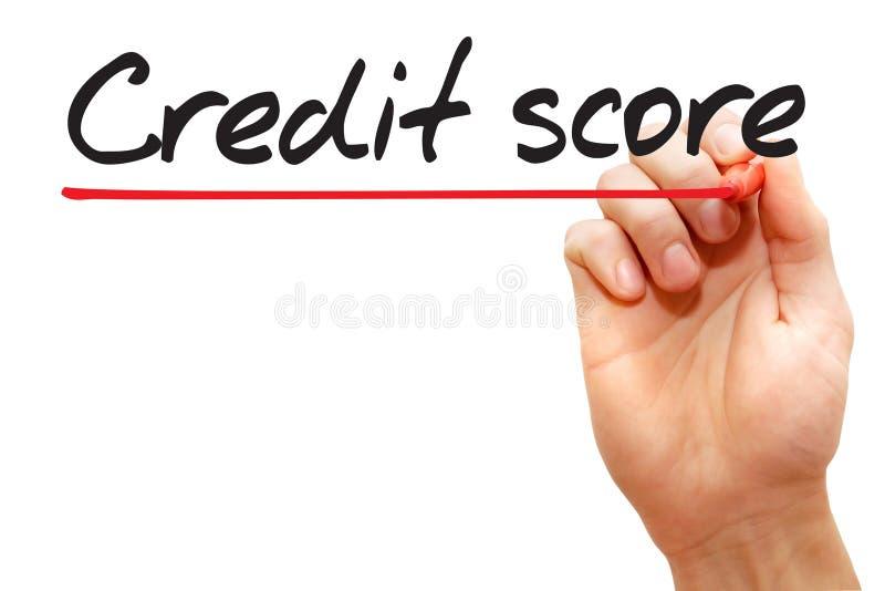 Mão que escreve a pontuação de crédito, conceito do negócio imagem de stock royalty free