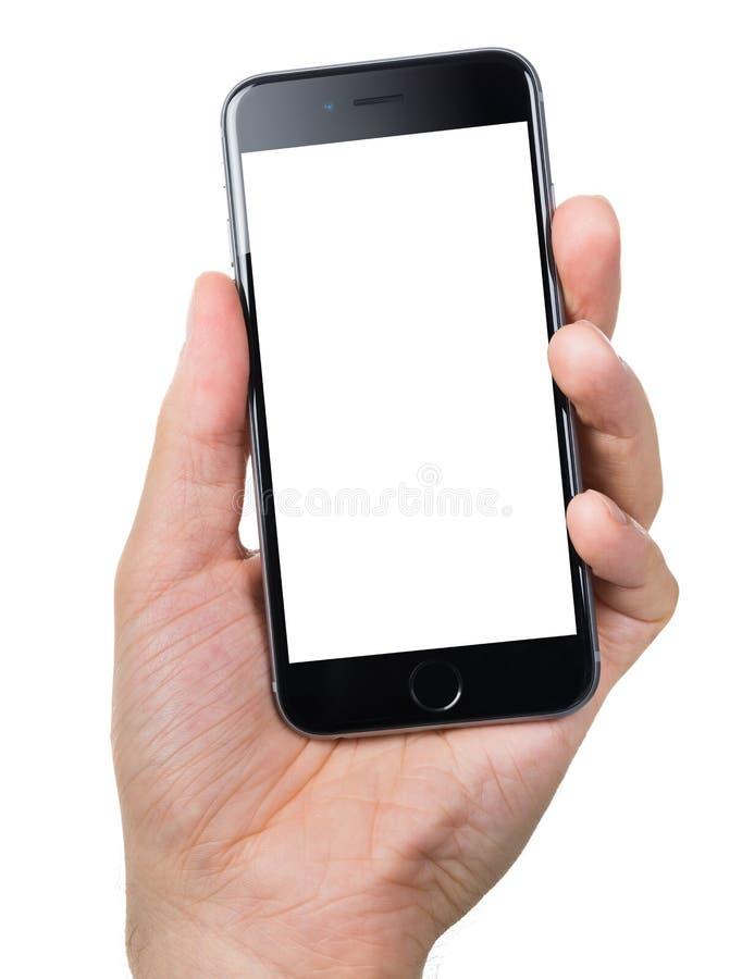Mão que guarda Apple iPhone6 com tela vazia foto de stock