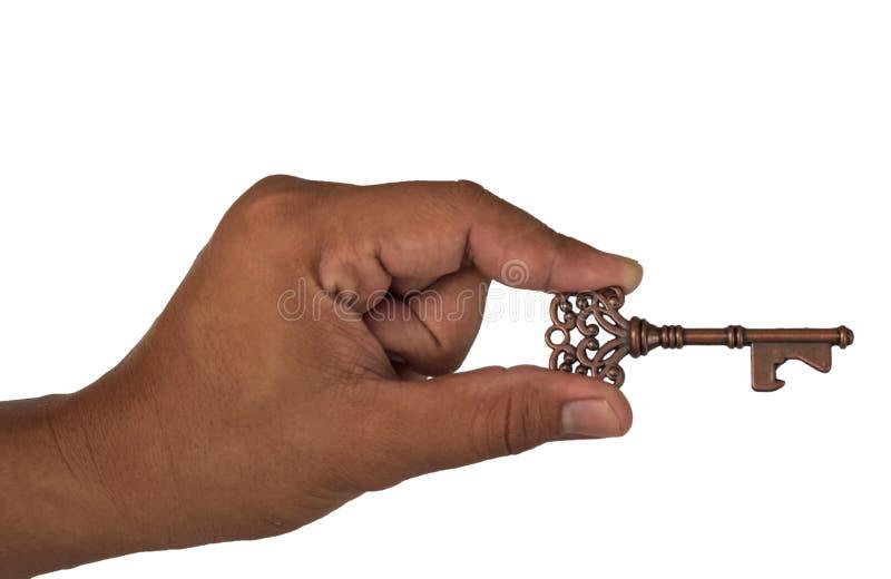 Mão que guarda a chave foto de stock
